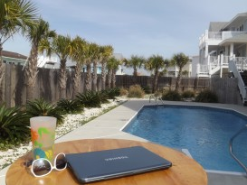 cup-glasses-closedlaptop-poolside